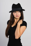Beautiful young Asian woman looks away. Royalty Free Stock Photos