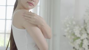 Beautiful young asian woman makeup of cosmetic, girl hand touch shoulder cream and lotion attractive