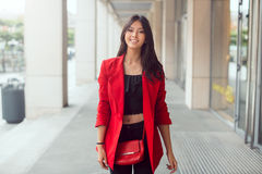 Beautiful young asian woman outdoors Stock Photo