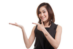 Beautiful young Asian woman point to palm hand. Royalty Free Stock Photos