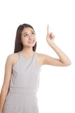 Beautiful young Asian woman point up to blank space Stock Photo