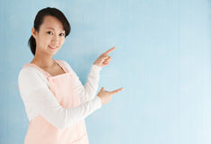 Beautiful young asian woman pointing Royalty Free Stock Images
