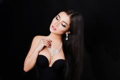 Beautiful young asian woman posing with jewelry Stock Image