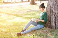 Beautiful young asian woman reading book Stock Photos