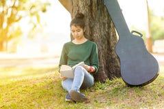 Beautiful young asian woman reading book Stock Photo