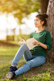 Beautiful young asian woman reading book Royalty Free Stock Images