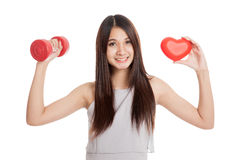 Beautiful young Asian woman with red heart and dumbbell Royalty Free Stock Photography
