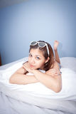 Beautiful young Asian woman relaxing on the bed Stock Photo