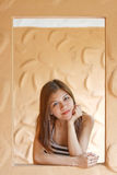 Beautiful young Asian woman relaxing on the window Royalty Free Stock Photo