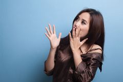 Beautiful young Asian woman shocked  and look up. Stock Image
