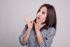 Beautiful young Asian woman shocked  and look up. Stock Photography