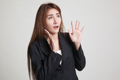 Beautiful young Asian woman shocked  and look up. Royalty Free Stock Photos