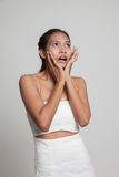Beautiful young Asian woman shocked  and look up. Stock Photo