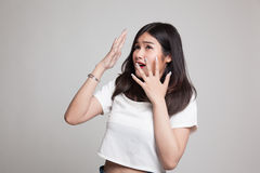 Beautiful young Asian woman shocked  and look up. Royalty Free Stock Photo