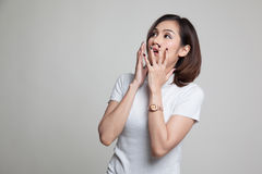 Beautiful young Asian woman shocked  and look up. Royalty Free Stock Photography
