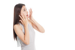 Beautiful young Asian woman shocked  and look up Stock Photos