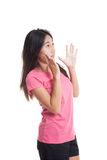 Beautiful young Asian woman shocked and look up Stock Photo