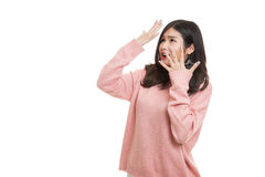 Beautiful young Asian woman shocked  and look up. Royalty Free Stock Image