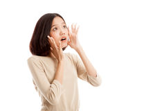 Beautiful young Asian woman shocked  and look up Royalty Free Stock Photos