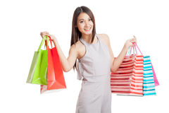 Beautiful young Asian woman with shopping bags Royalty Free Stock Images
