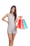 Beautiful young Asian woman with shopping bags Stock Images