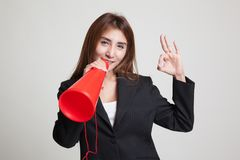 Beautiful young Asian woman show OK  announce with megaphone. Stock Images