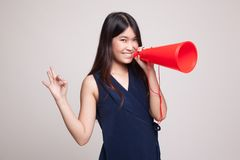 Beautiful young Asian woman show OK  announce with megaphone. Royalty Free Stock Photo