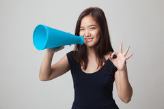 Beautiful young Asian woman show OK  announce with megaphone. Royalty Free Stock Photos