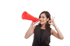Beautiful young Asian woman show OK  announce with megaphone. Royalty Free Stock Photography