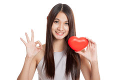 Beautiful young Asian woman show OK  with red heart Stock Photos