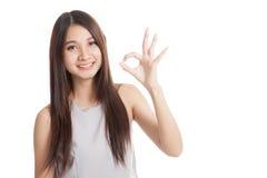 Beautiful young Asian woman show OK sign Stock Photos