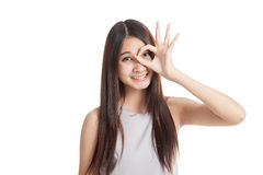 Beautiful young Asian woman show OK sign over her eye Stock Images
