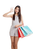 Beautiful young Asian woman show OK sign with shopping bags Royalty Free Stock Photography