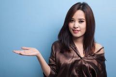 Beautiful young Asian woman show palm hand. Stock Image