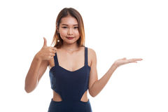 Beautiful young Asian woman show palm hand and thumbs up. Royalty Free Stock Photos
