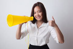 Beautiful young Asian woman show thumbs up announce with megapho Royalty Free Stock Photography