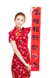 Beautiful young asian woman showing  Spring festival couplets Stock Image