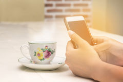 Beautiful young asian woman sitting on chair relaxing coffee tim Royalty Free Stock Photo
