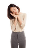 Beautiful young Asian woman with sleeping gesture. Isolated on white background stock image