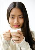 Beautiful young asian woman smiling with cup of coffee Royalty Free Stock Photography