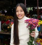 Beautiful young asian woman smiling with flowers Royalty Free Stock Image