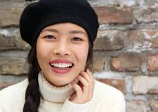 Beautiful young asian woman smiling with hat Stock Images