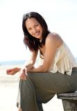 Beautiful young asian woman smiling outdoors Stock Photo