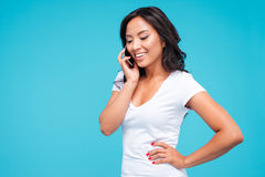 Beautiful young asian woman talking on the mobile phone Royalty Free Stock Photo