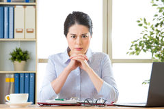 Beautiful young asian woman thinking with headache Stock Photo