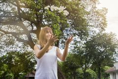 Beautiful young asian woman throw a white flowers up in the air Stock Photography
