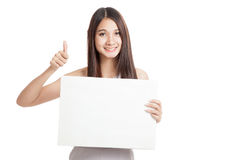 Beautiful young Asian woman thumbs up with blank sign Stock Photos