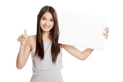 Beautiful young Asian woman thumbs up with blank sign Royalty Free Stock Photography