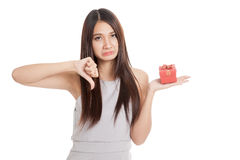 Beautiful young Asian woman unhappy with red gift box. Isolated on white background Stock Photos