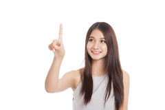 Beautiful young Asian woman use her finger touch a screen Royalty Free Stock Photo